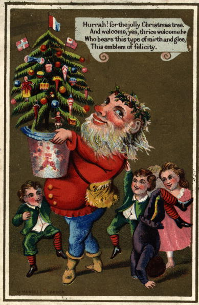 circa 1885: Father Christmas arrives with a Christmas tree to the delight of the children in this Victorian greetings card. J Mansell (Photo by Hulton Archive/Getty Images)