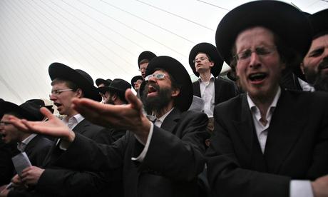 Ultra-Orthodox Jews attend a mass anti-draft rally in Jerusalem